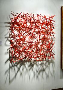 "Matt Devine, ""Ember #2,"" steel with red, 48x48x6 inches."